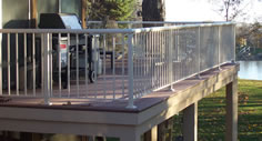 Residential picket aluminum railing photo with a view of a lake by Versadeck Decking